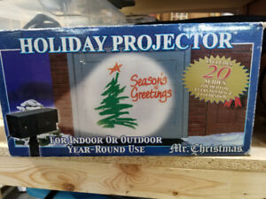 HOLIDAY PROJECTOR - $20