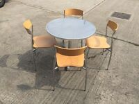 Patio Table & 4 Stacking Chairs. Table is 80cm across. Can deliver