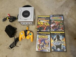 Nintendo Gamecube + all hook ups, 2 controllers and 4 games