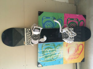 Snowboard with Burton bindings and Oakley goggles