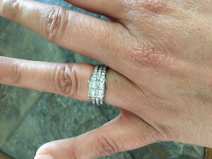 A beautiful engagement ring and wedding band, set in 14k white g