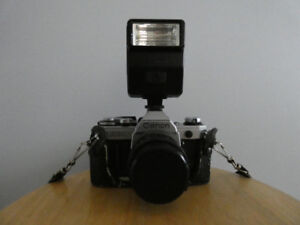 Canon AE-1 35mm film Camera with two lenses and Speedlite