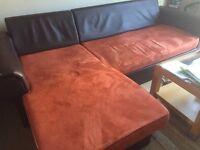 Corner sofa bed in terracotta
