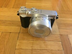 Nikon 1 J5 (sold) with 10-30mm lens (still available)