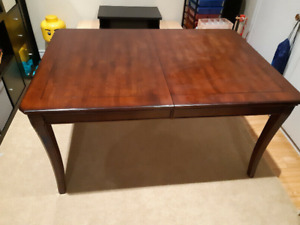 Beautiful Extendable Hard Wood Dining Table