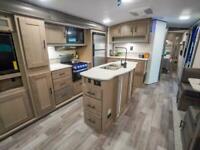 2021 HEARTLAND SUNDANCE 293RL FIXED BED American Caravan 5th Wheel RV Showman