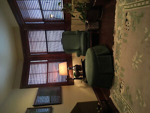 Matching chair and ottoman for sale