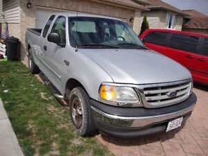 2002 ford f150 four door v6 auto ti is gry runs excellent im st