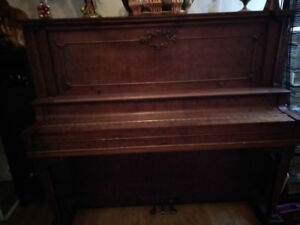 Century old upright piano for the taking. Needs a tune up.