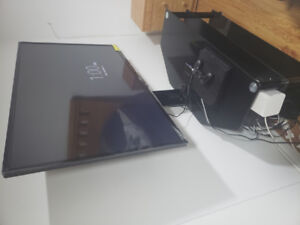"""55"""" Sanyo tv with mounted glass stand"""