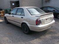 Mazda Protege LX, Automatique 127000 KM. Pneus Hiver.
