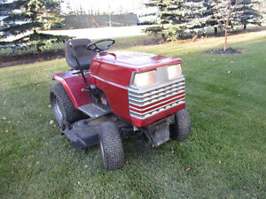 Craftsman 18hp 6 sp tractor with 44 inch mower and snowblower