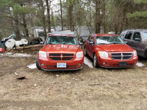Two Dodge Calibers, make an offer.