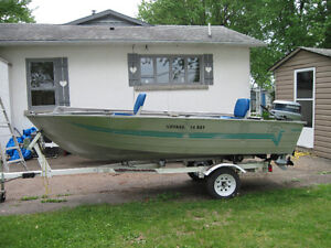 DISCOVERY VOYAGER 14 FT..DEEP WIDE WITH 20 HP EVINRUDE AND TRAIL