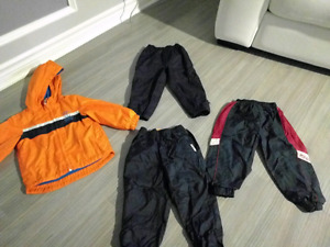 3 pairs of splash pants and an Oshkosh coat