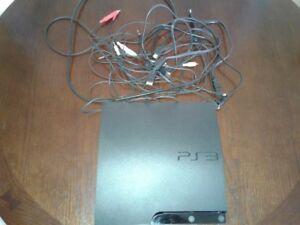 PS3 with accessories and 18 games. 1 remote works great.
