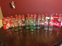Lot of coca cola collectible empty bottles