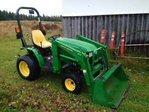 JOHN DEERE Compact Tractor with front snow blower/mower