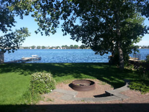 Reno'd shared house backing on Lake Chestermere with dock- w/d