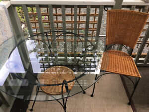 Ironwork with Glass table top with 3 high end wicker chairs