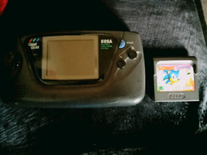 100 obo Sega game gear with sonic hedgehog game