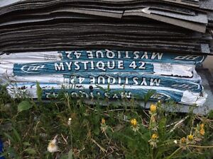 4 unopened bags of mystique 42 roof shingles