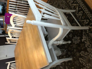 Solid Birch Dining room table with 8 chairs & two leaves.