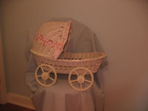 WICKER DOLL BED WITH WHEELS