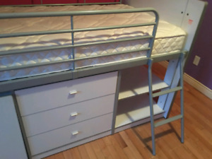 Beautiful loft bed complete with mattress and slide-out desk. Tw