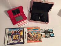 Red Nintendo DS lite bundle with 8 games, charger and carry case