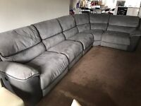 Large corner sofa with electric recliners