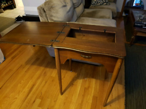 Solid antique sewing machine table.
