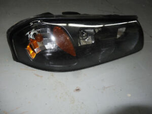 2005 Impala Pass. Side Headlight. Includes bulbs