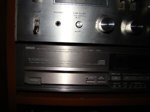 Yamaha CDX-920 CD player with factory remote.