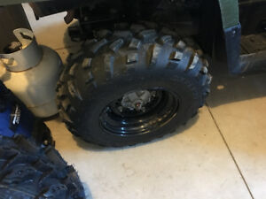 2 Complete sets of Carlisle At 489 tires and rims for sale.