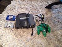 N64 console, with two controllers and two games $80