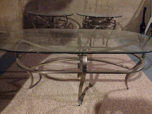 Glass tables with silver stands