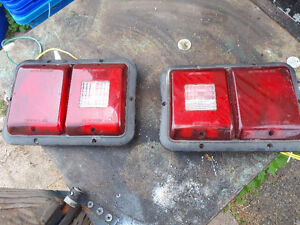 pair of trailer lights  also have other lights and accessories