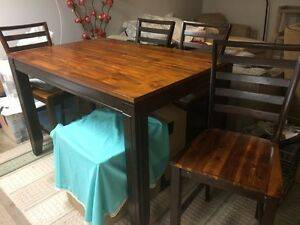 Counter top height table with 4 high chairs