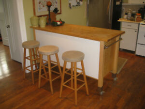 Large Ikea counter with maple butcher-block top.