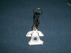 UNIQUE & COLLECTIBLE TELEPHONE KEYCHAIN-PEWTAR?-VINTAGE!