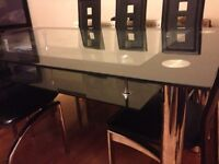 Glass rectangular dining table and chairs