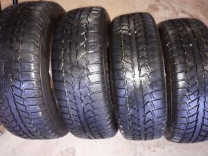 Set of four -  205/65 R16 winter tires on rims