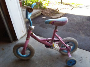 Pink bike with training wheels