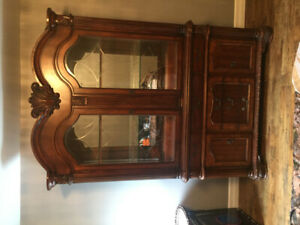 Large Solid Dinning Table and Matching Hutch.