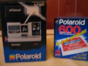 Polaroid Sun 600 LMS with box and extra film (Collectible)