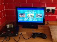 Sega megadrive 2 with 6 games on one cart