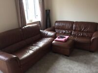 2 x Brown leather 3 seater sofas and storage footstool
