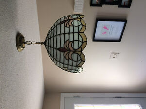 Custom made stained glass light fixture.