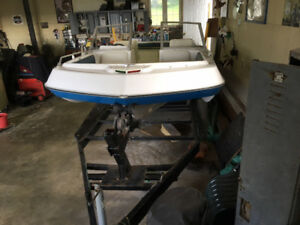 Tri hull fiberglass boat, motor and trailer